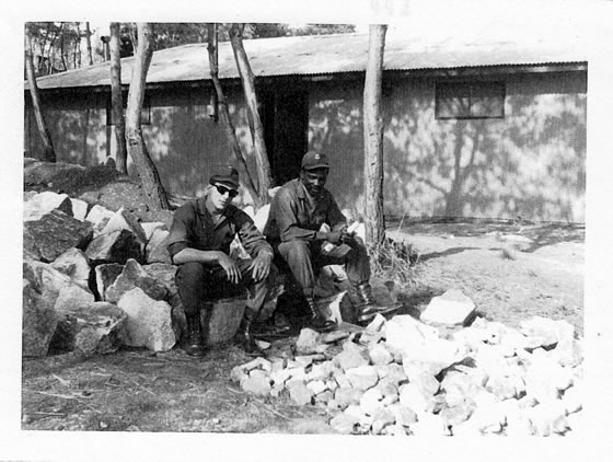 Jim & comrade sitting on rocks ~ Korea 1969